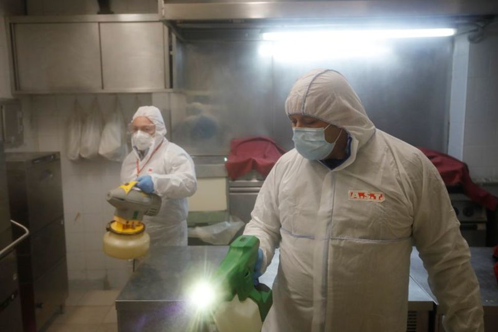 REUTERS – ITALY'S DAILY CORONAVIRUS DEATH TOLL EDGES UP, BUT NEW CASES FALL